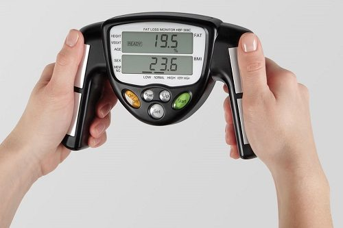 Holding Fat Analyzer In Hands
