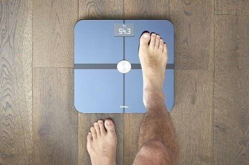 Man Stepping On Smart Scale